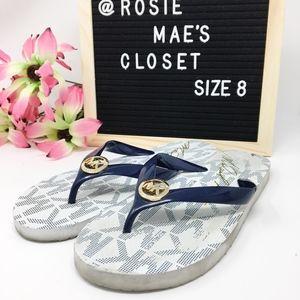 Michael Kors Shoes - Michael Kors Navy & White Gold MK Flip Flops Sz 8